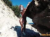 Travel slut teases a videographer and fucks him on the beach